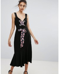 Vestido midi con print de flores negro de Warehouse