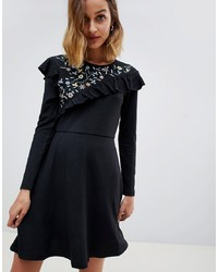 Vestido skater con print de flores negro de Angel Eye