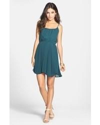 Combinar vestido azul verdoso