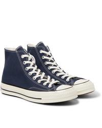 Zapatillas altas de lona azul marino de Converse