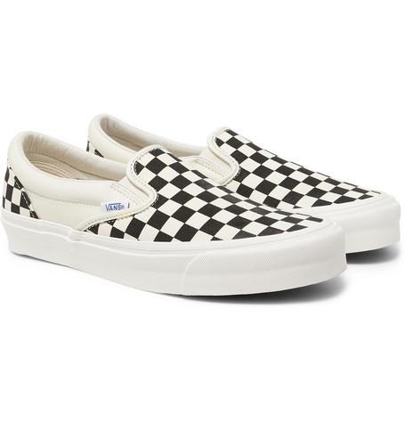Zapatillas slip on de lona a cuadros en negro y blanco de Vans