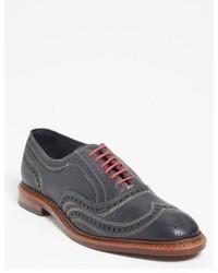 Zapatos brogue de cuero en gris oscuro
