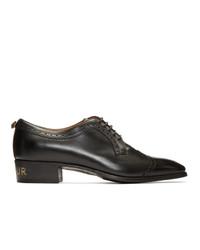 Zapatos brogue de cuero negros de Gucci