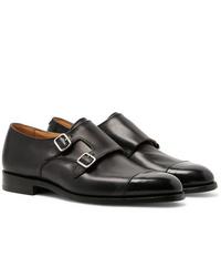 Zapatos con doble hebilla de cuero negros de Tricker's