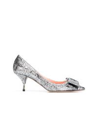 Zapatos de tacón de cuero con adornos plateados de Rochas