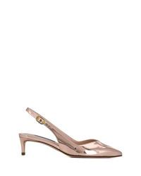 Zapatos de tacón de cuero dorados de Stuart Weitzman