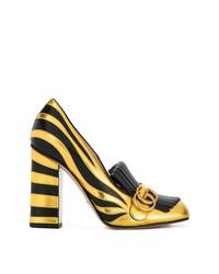 Zapatos de tacón de cuero en negro y dorado de Gucci