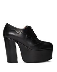 Zapatos de tacón de cuero gruesos negros de Gucci