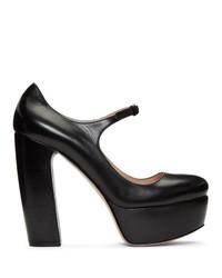 Zapatos de tacón de cuero gruesos negros de Miu Miu