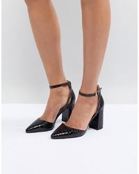 Zapatos de tacón de cuero negros de RAID