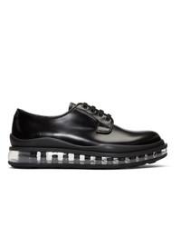 Zapatos derby de cuero negros de Prada