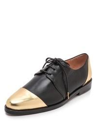 Zapatos oxford de cuero en negro y dorado