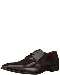 Zapatos oxford en marrón oscuro de Versace
